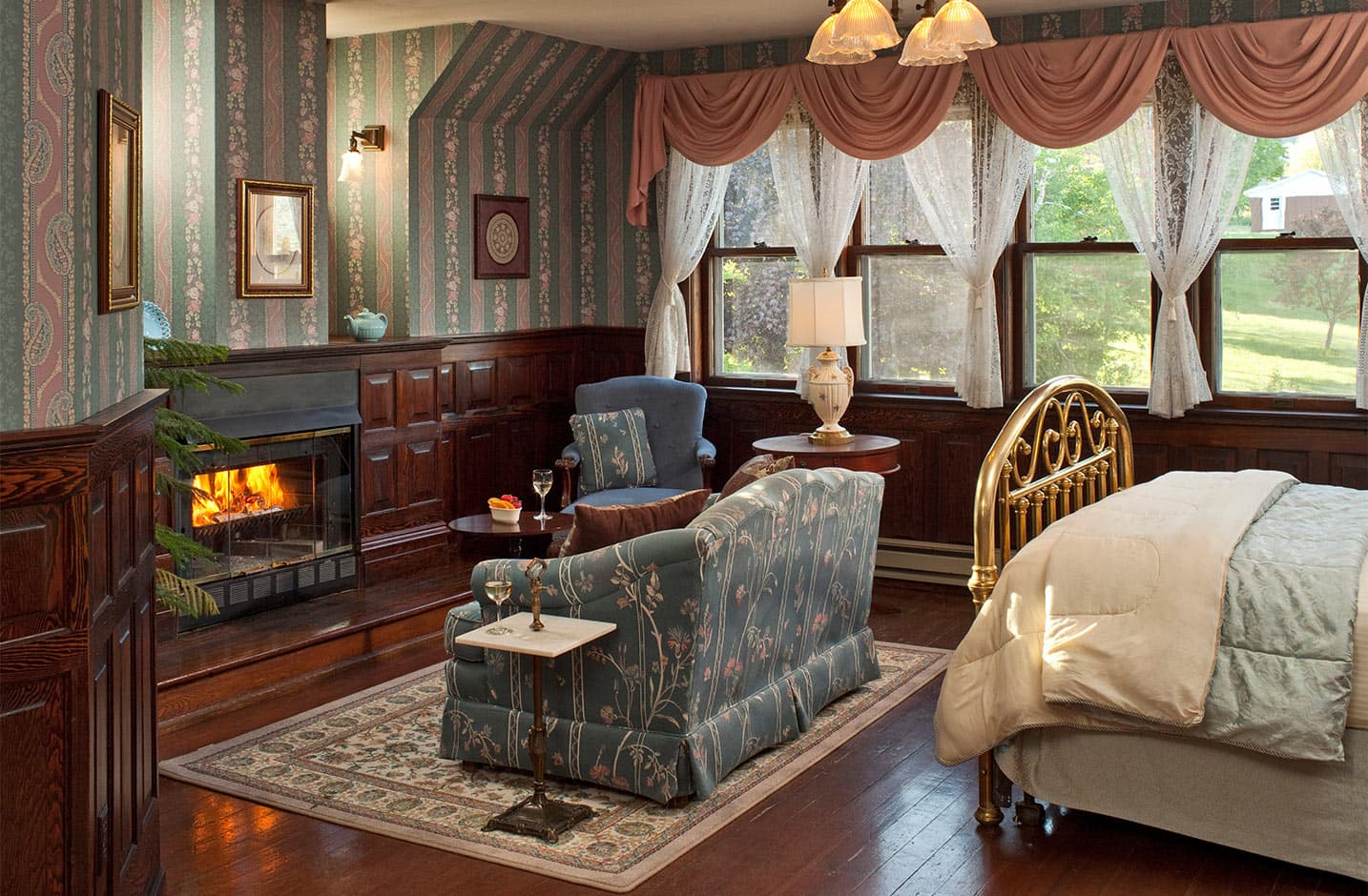 Ballroom at Le Chateau fireplace, couch, and bed