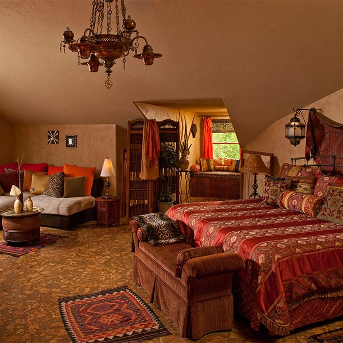 Bed, Window seat, and sitting area in Moroccan Suite