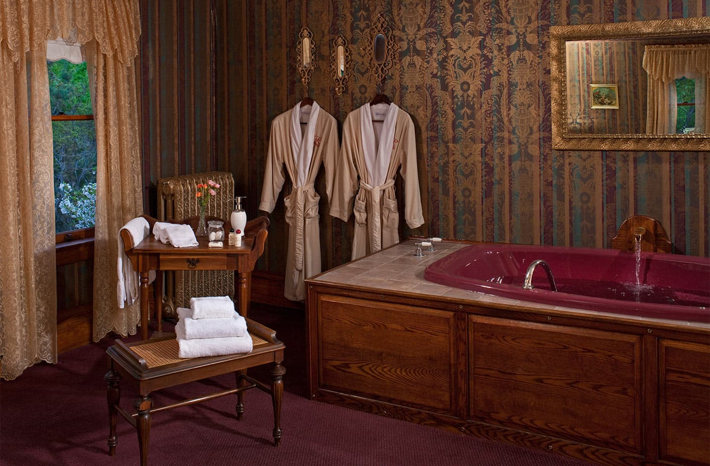 Whirlpool tub with two bath robes and towels